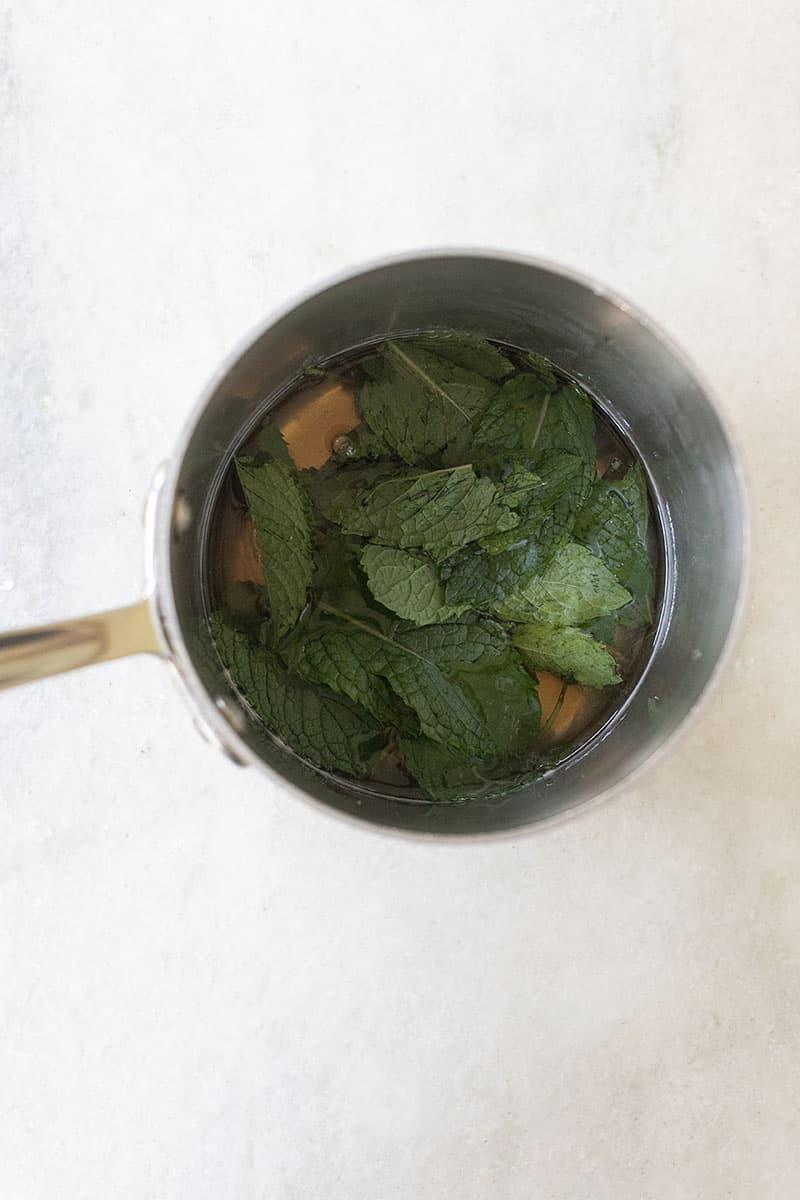 Mint inside a pan infusing sugar.