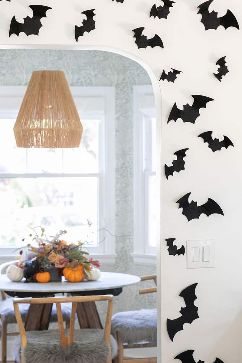 Felt bats on a kitchen wall.