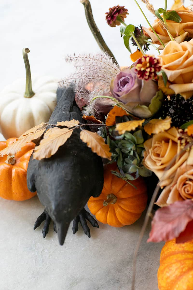 Halloween floral arrangements and pumpkins.