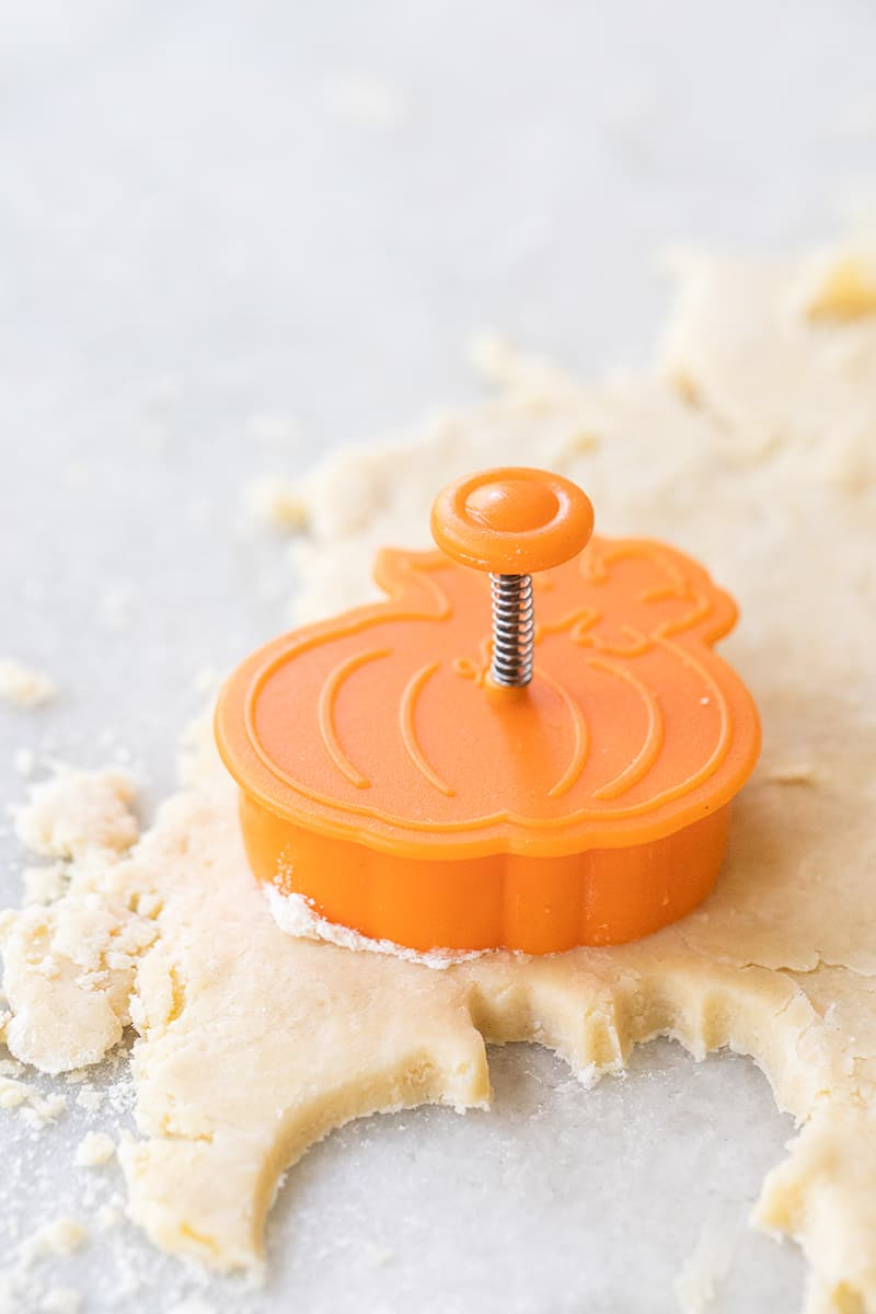 Pumpkin pie cutout stamping pie dough to make cute pie cutouts