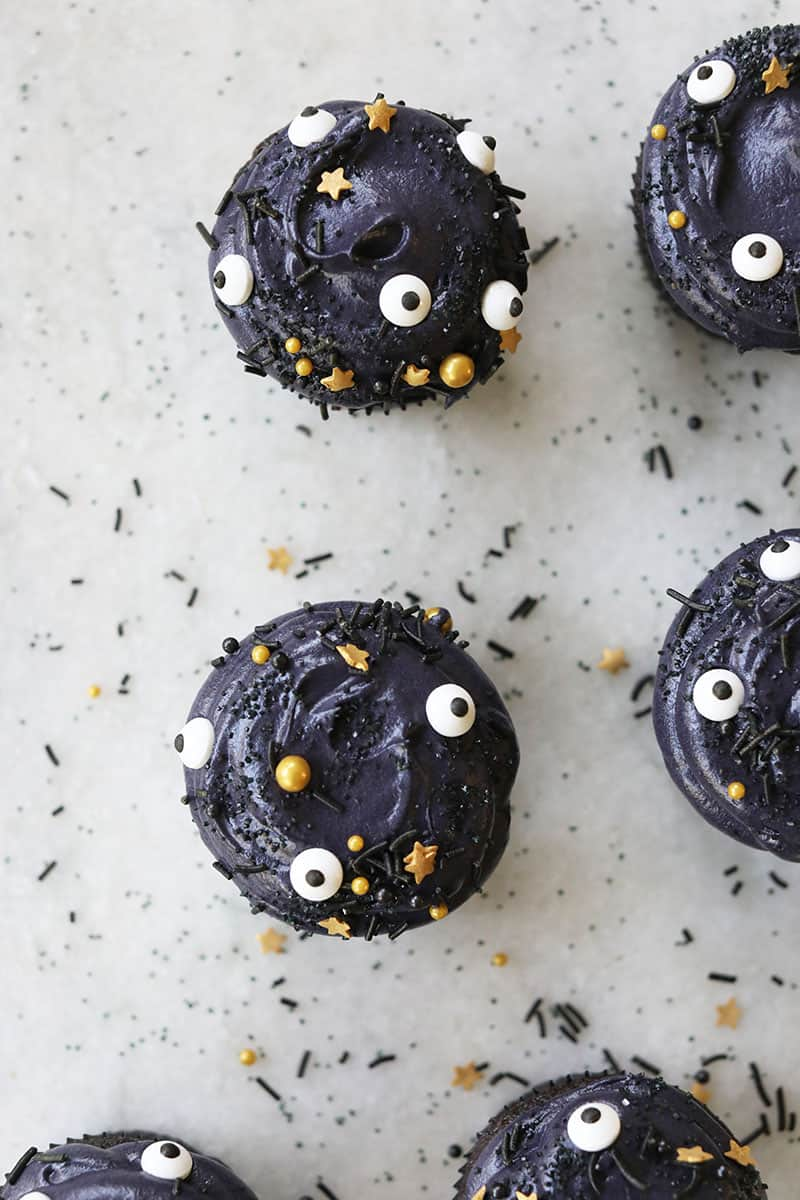 Halloween food ideas for kids, make these black velvet Halloween cupcakes with sprinkles.
