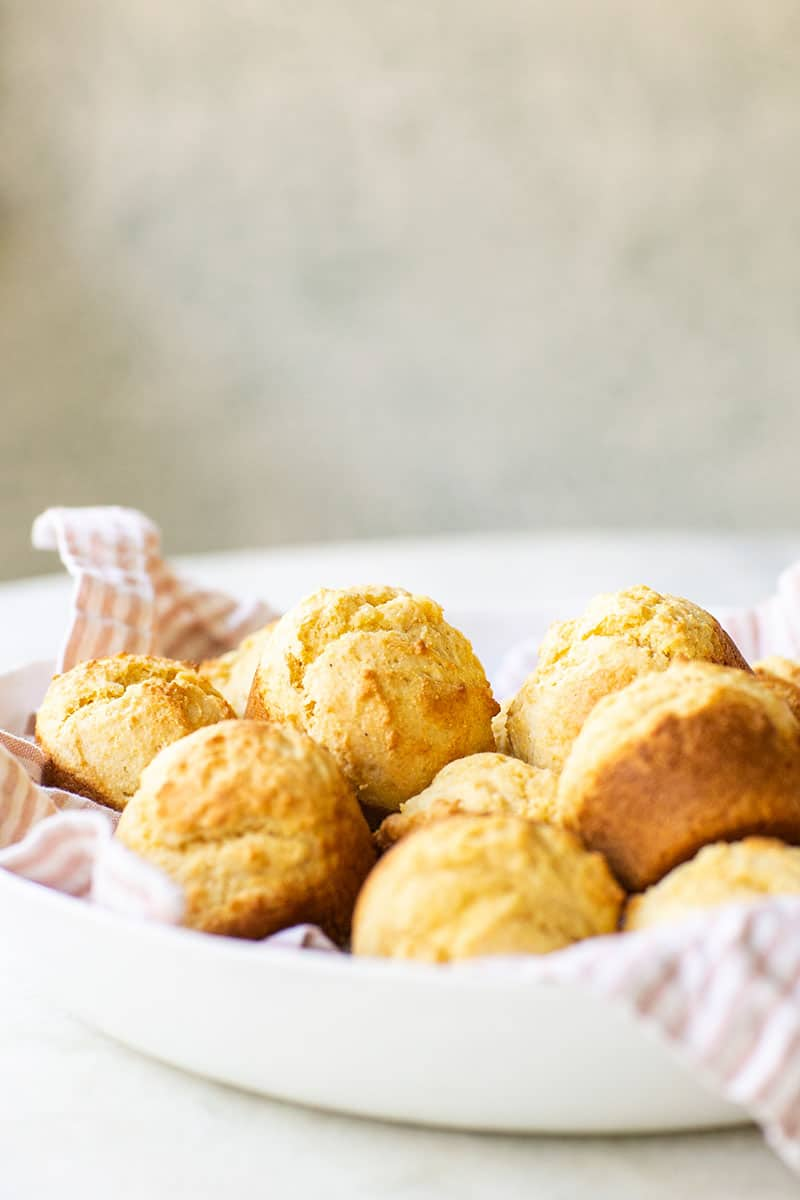 Cornbread muffins in a white bowl.
