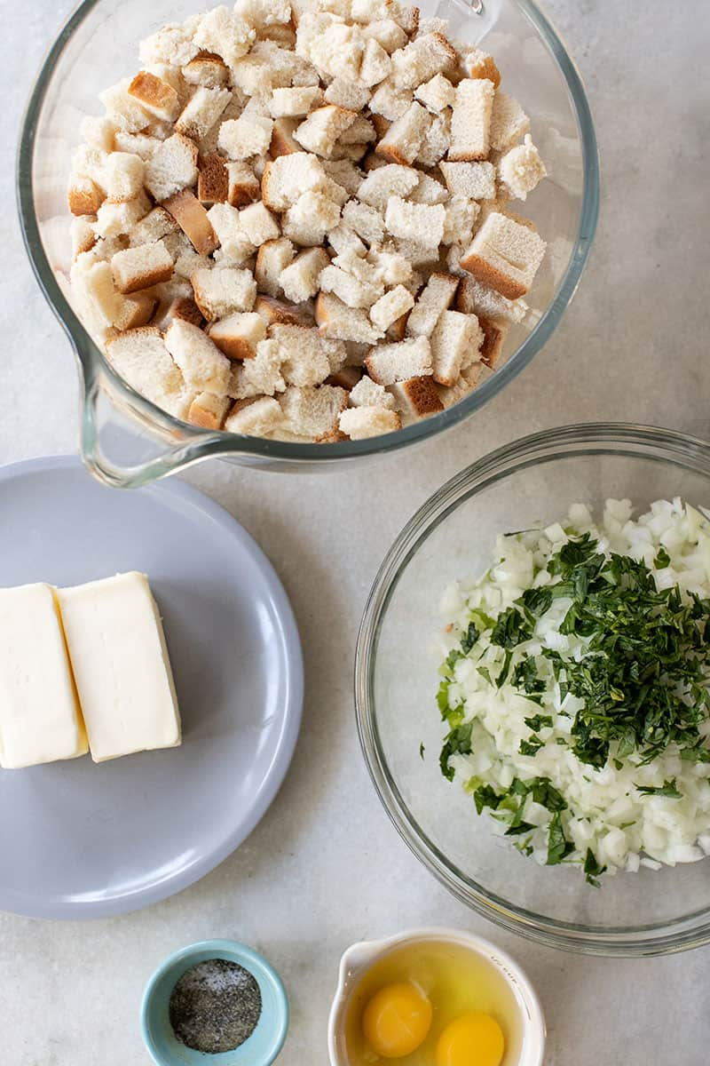 Cubed bread, onions and butter. All ingredients to make Thanksgiving stuffing.