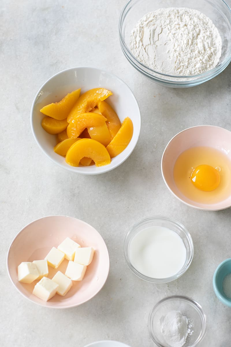 Peaches, flour and an egg yolk to make an easy peach cake.