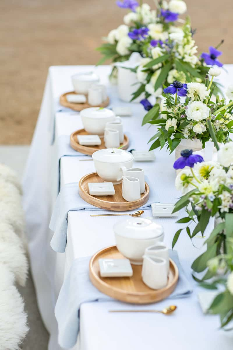 tea party bridal shower with flowers, linens and decorations.