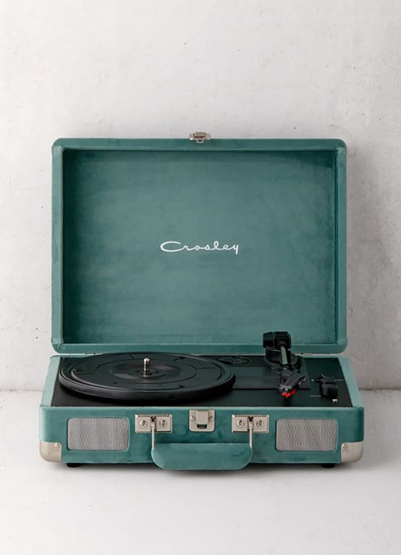 A green crossly record player for playing Christmas Music and playing Christmas songs.