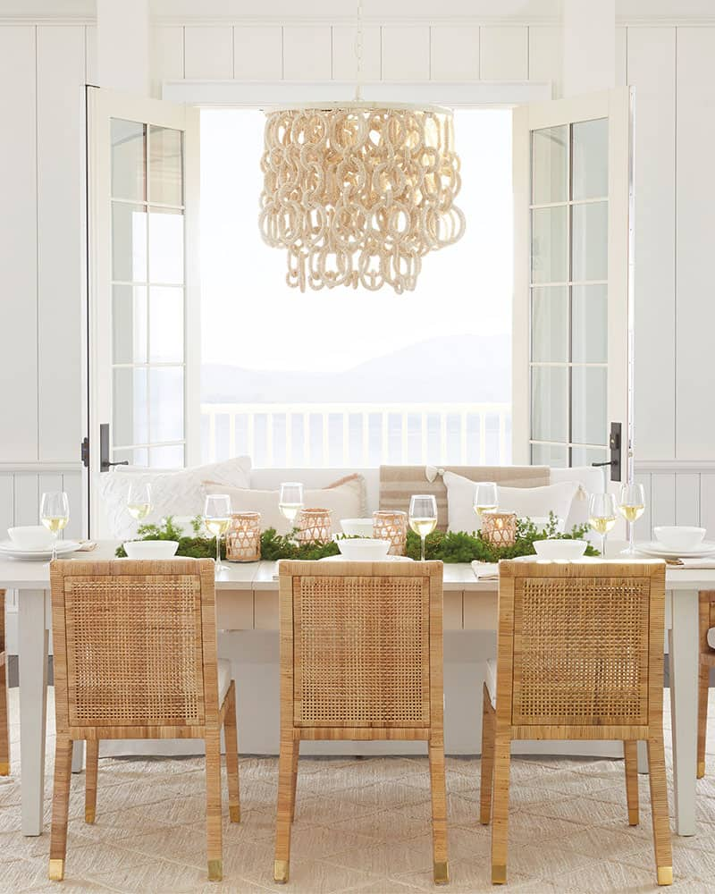 Dining room with rattan chairs.