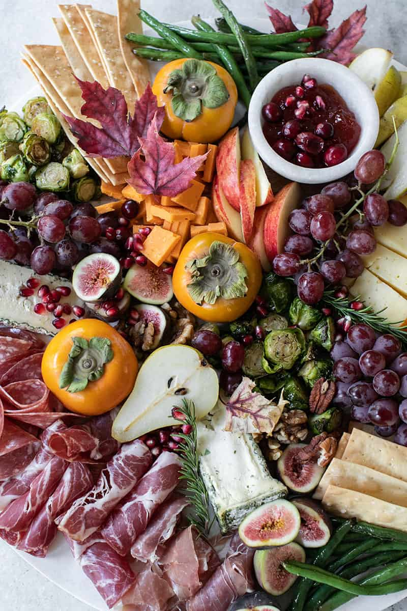 Cheese Board for fall with meat, cheese, pears, figs, apples, grapes and green beans.