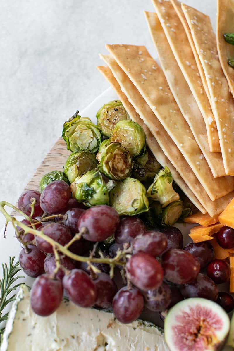 Thanksgiving appetizer board with grapes.