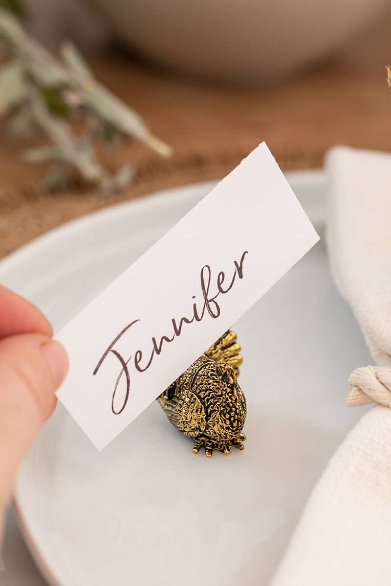 Adding a name card into a gold turkey holder