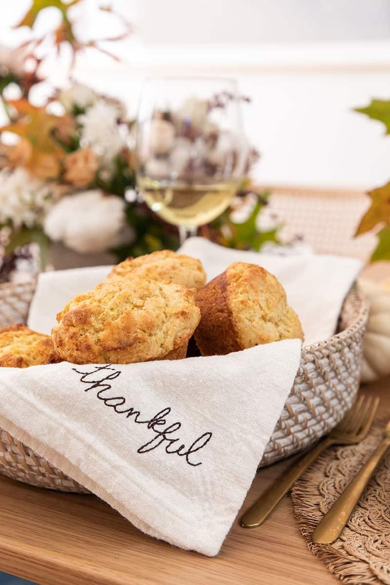 Cornbread muffins in a basket.