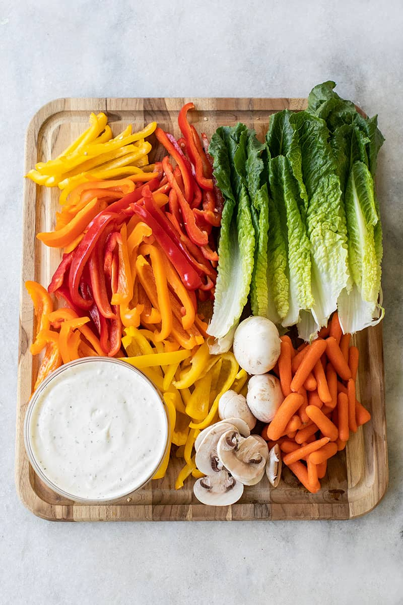 Vegetables on a cutting board to make a Thanksgiving vegetable platter for kids.