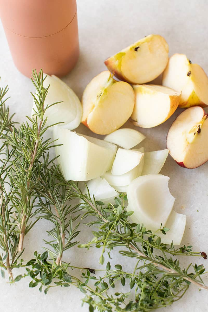 Apples, onions, rosemary and thyme to fill the inside of a turkey before cooking.