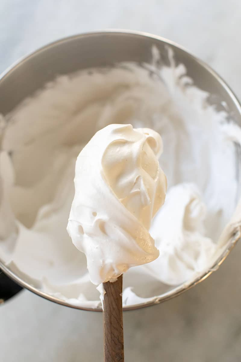 Homemade marshmallow fluff on a wooden spoon.