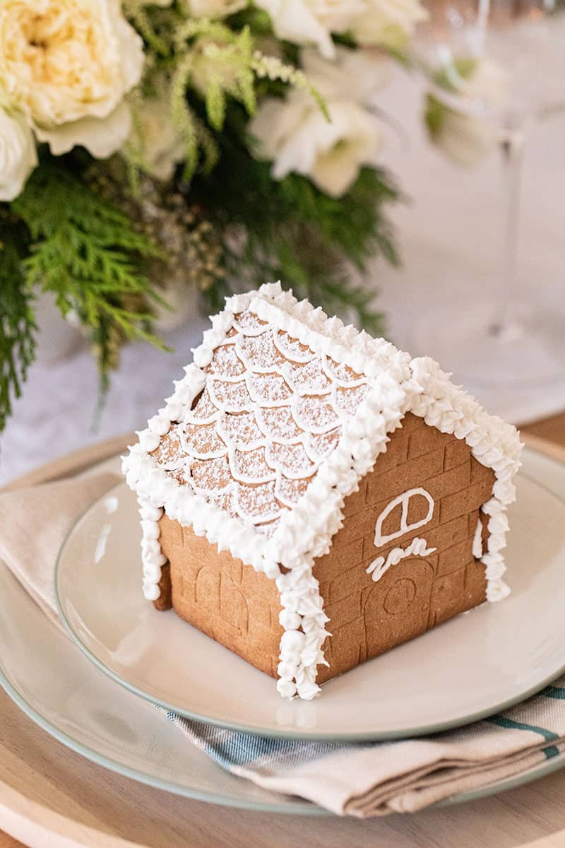 Small gingerbread house with Zan written on it in frosting.