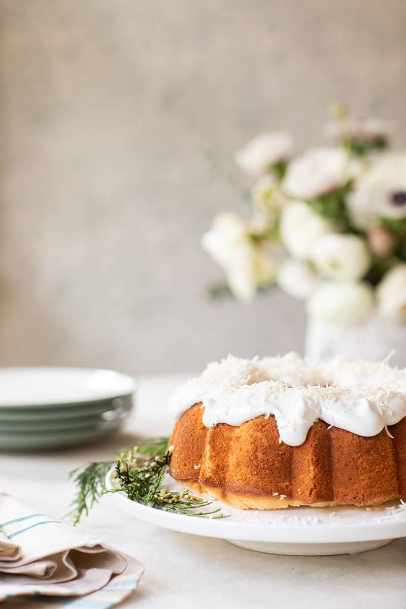 Classic southern coconut bunt cake on a footed cake stand.