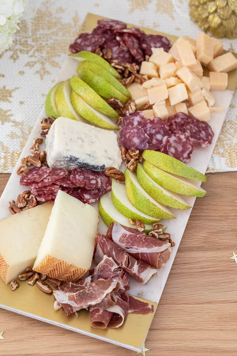 Meat and cheese board with pears from Harry & David.