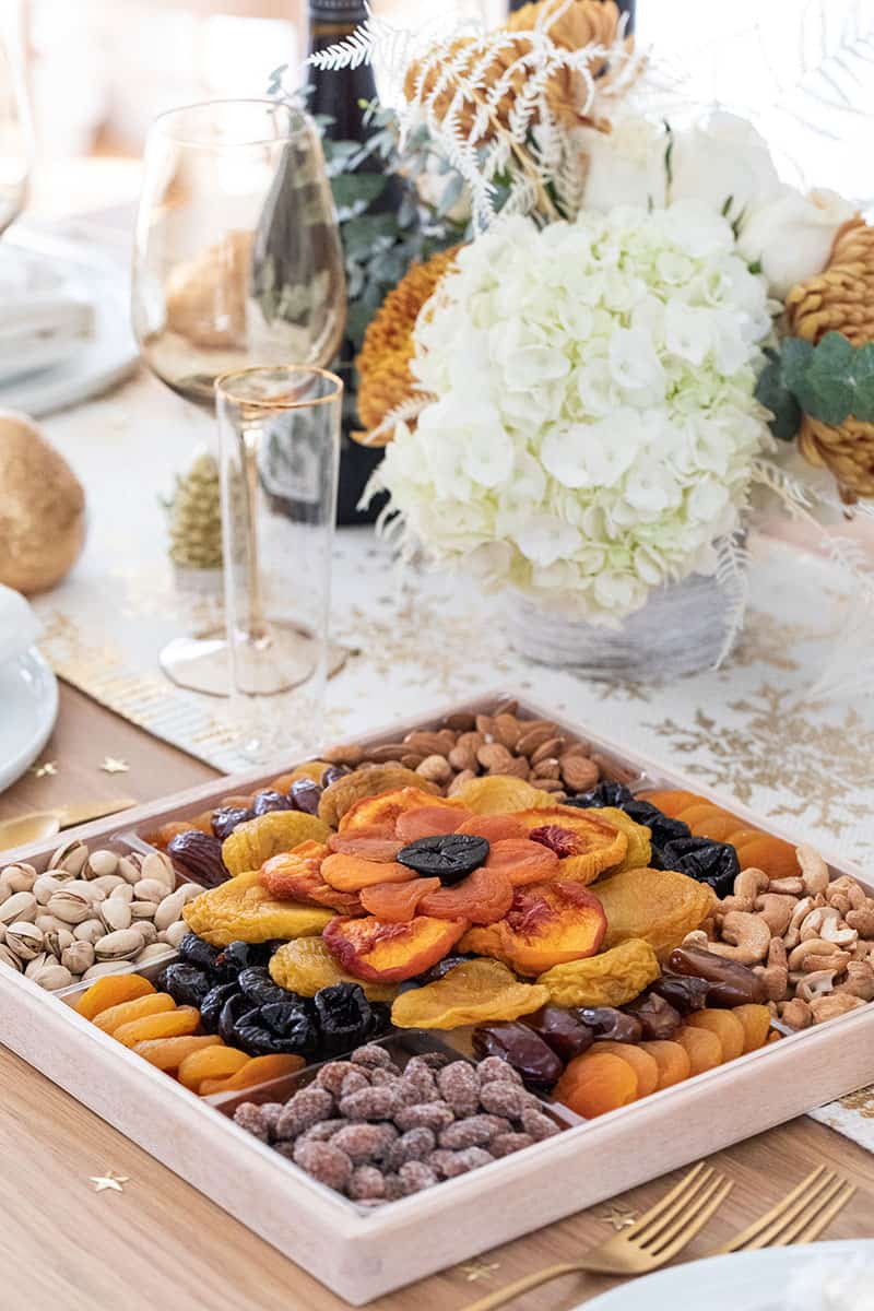 Dried fruit platter on a Christmas table setting.