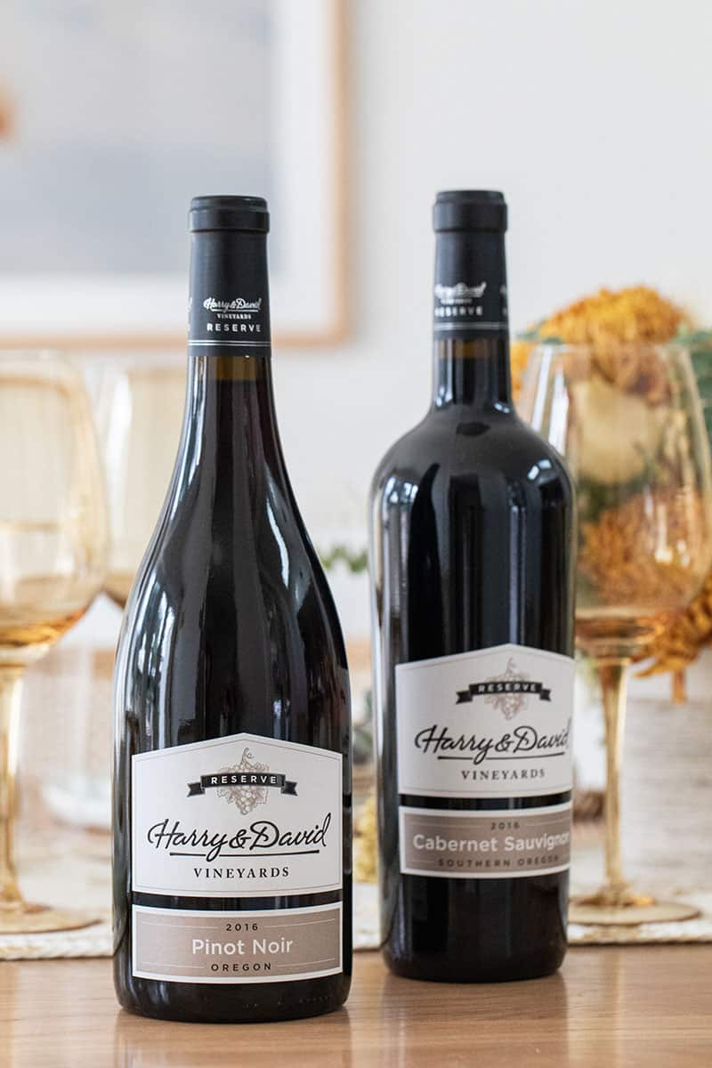 Bottle of Harry & David Pinot Noir and a bottle of Harry & David Cabernet.