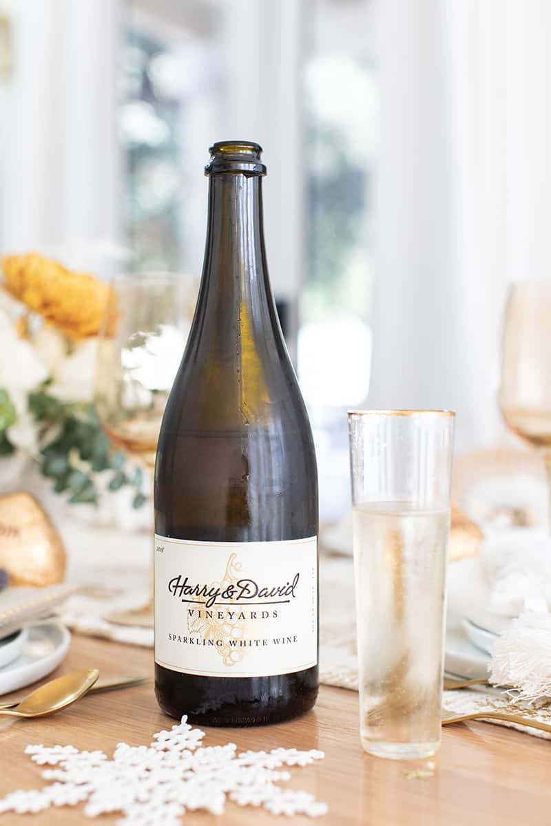 Harry & David sparkling white wine on a Christmas brunch table setting.