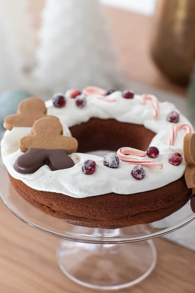 Gingerbread bunt cake with gingerbread men and berries and candy canes.