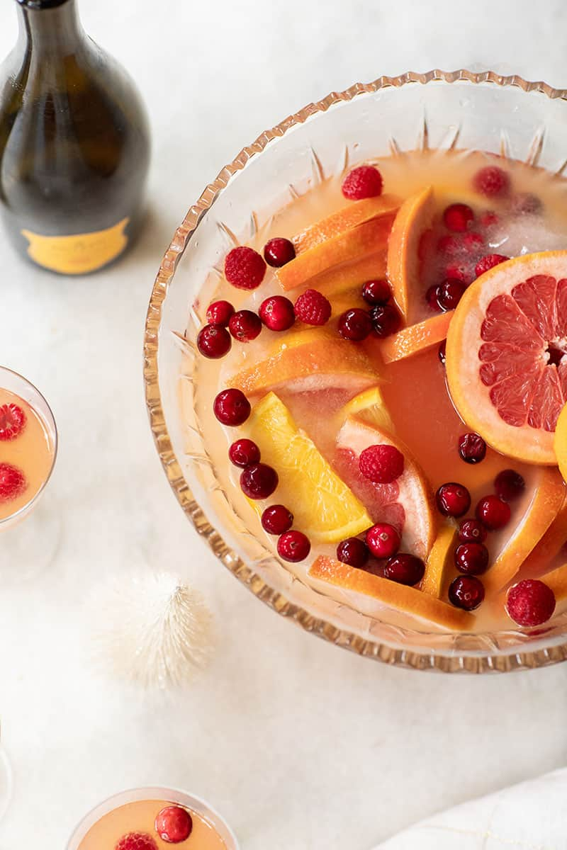Citrus holiday punch with Prosecco, gin, oranges, grapefruit, cranberries and raspberries.