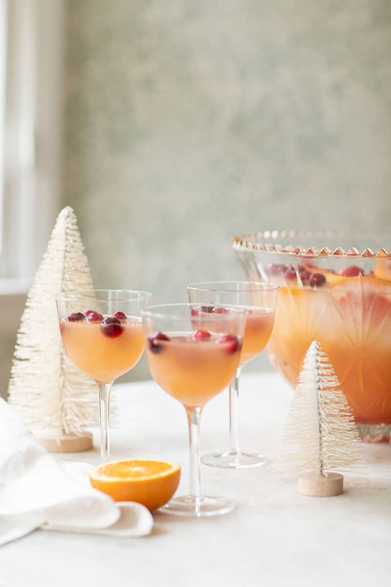 Coupes filled with citrus holiday punch recipe for a holiday party.