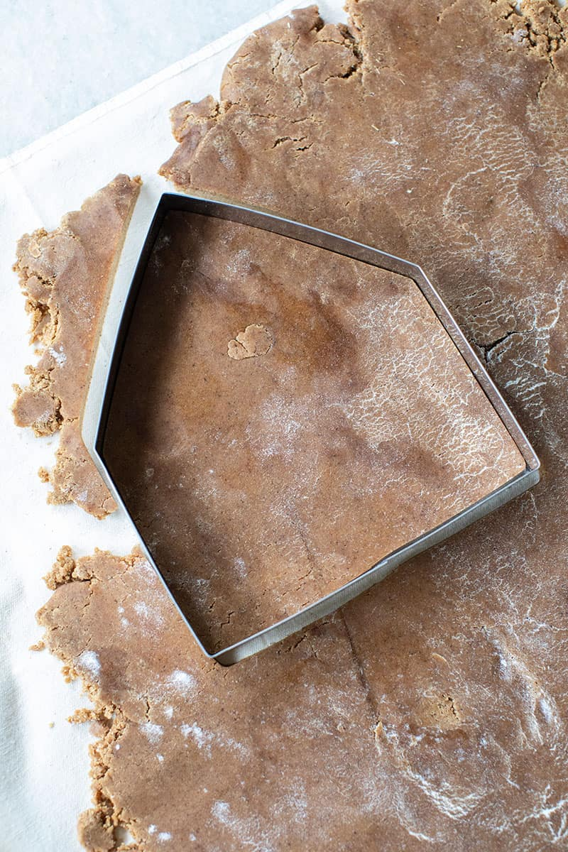 Gingerbread dough and cookie cutter.