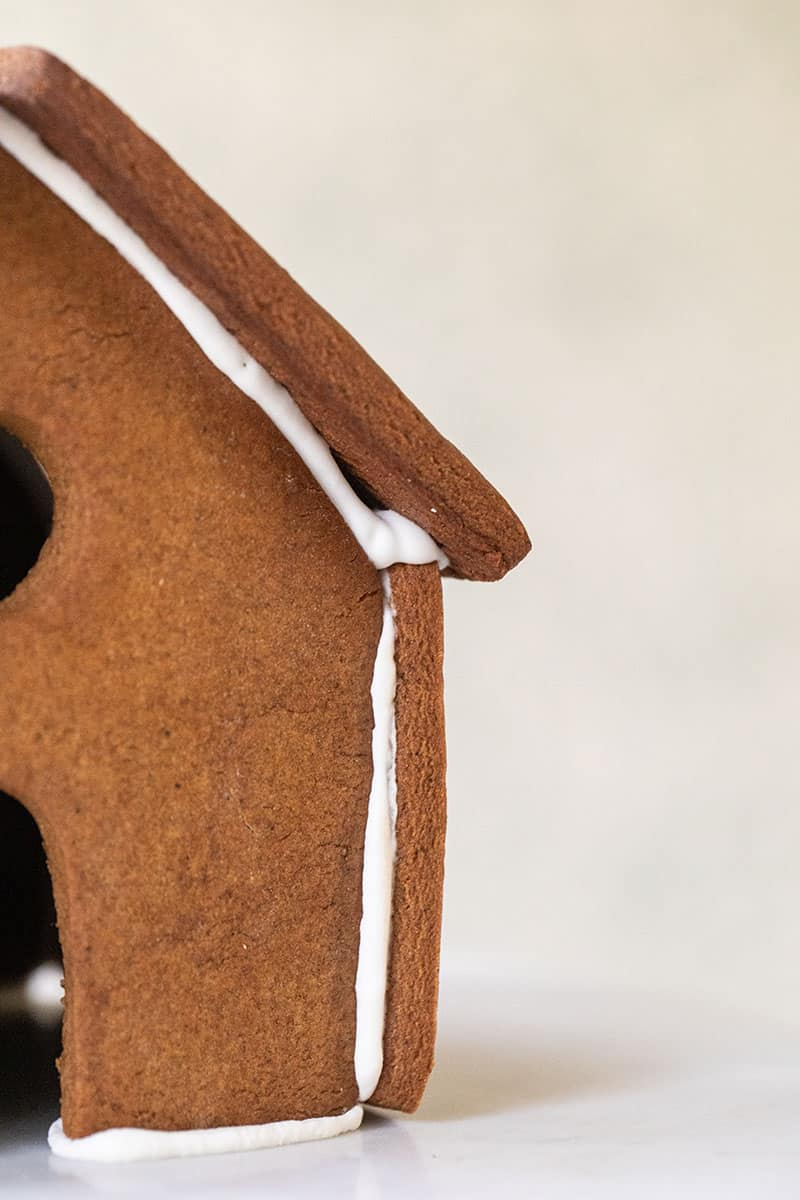 Building a gingerbread house with royal icing.