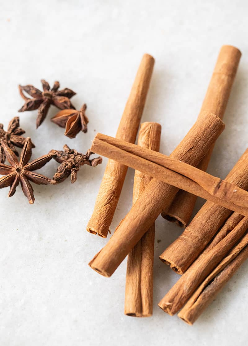 cinnamon sticks, star anis on a marble table.