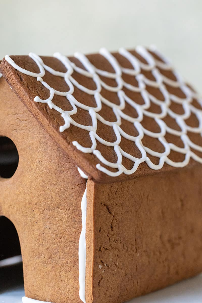 Royal icing detail on a gingerbread house roof.