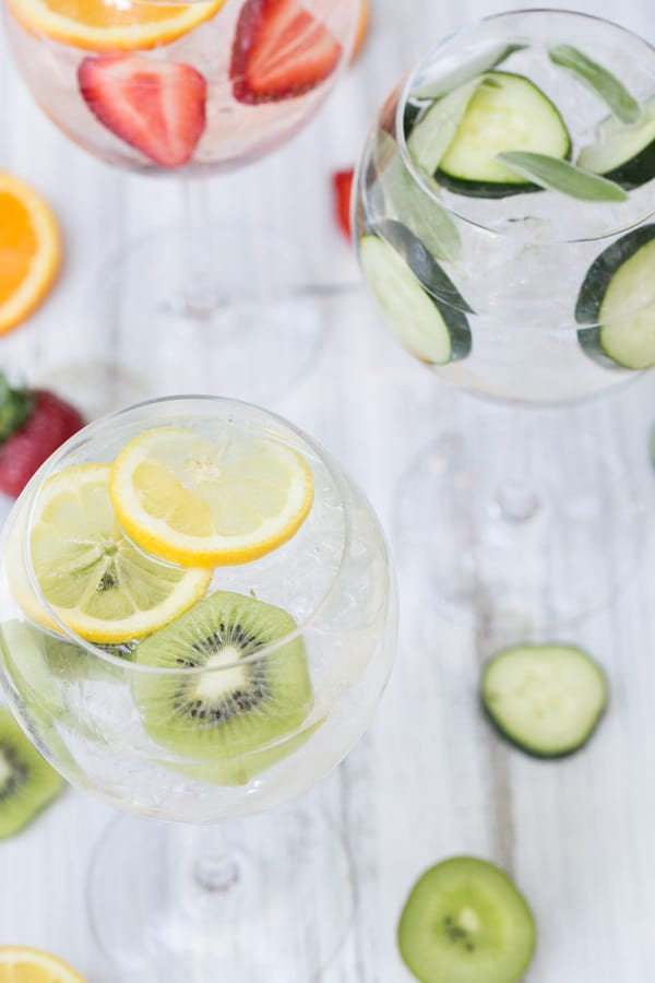 Classic, Spanish gin and tonics served in round glasses with sliced fruit.
