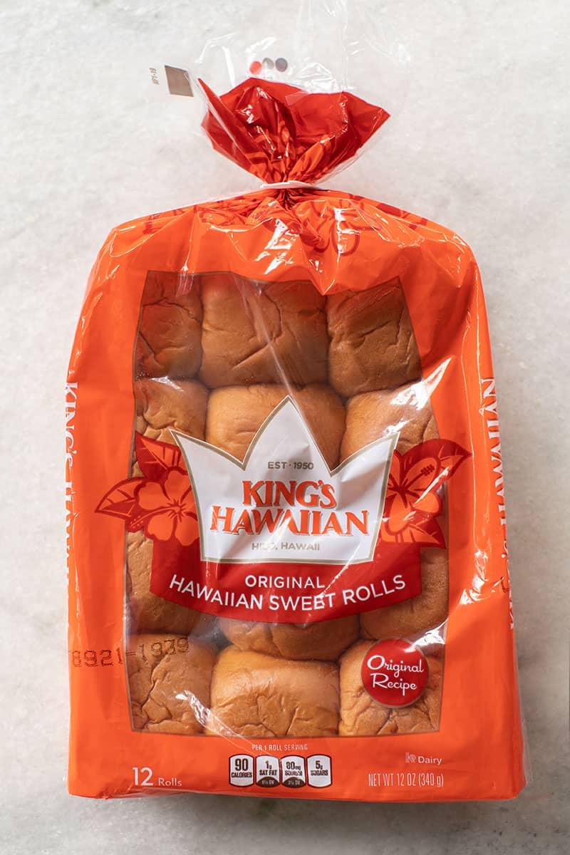 1 bag of King's Hawaiian rolls on a marble table