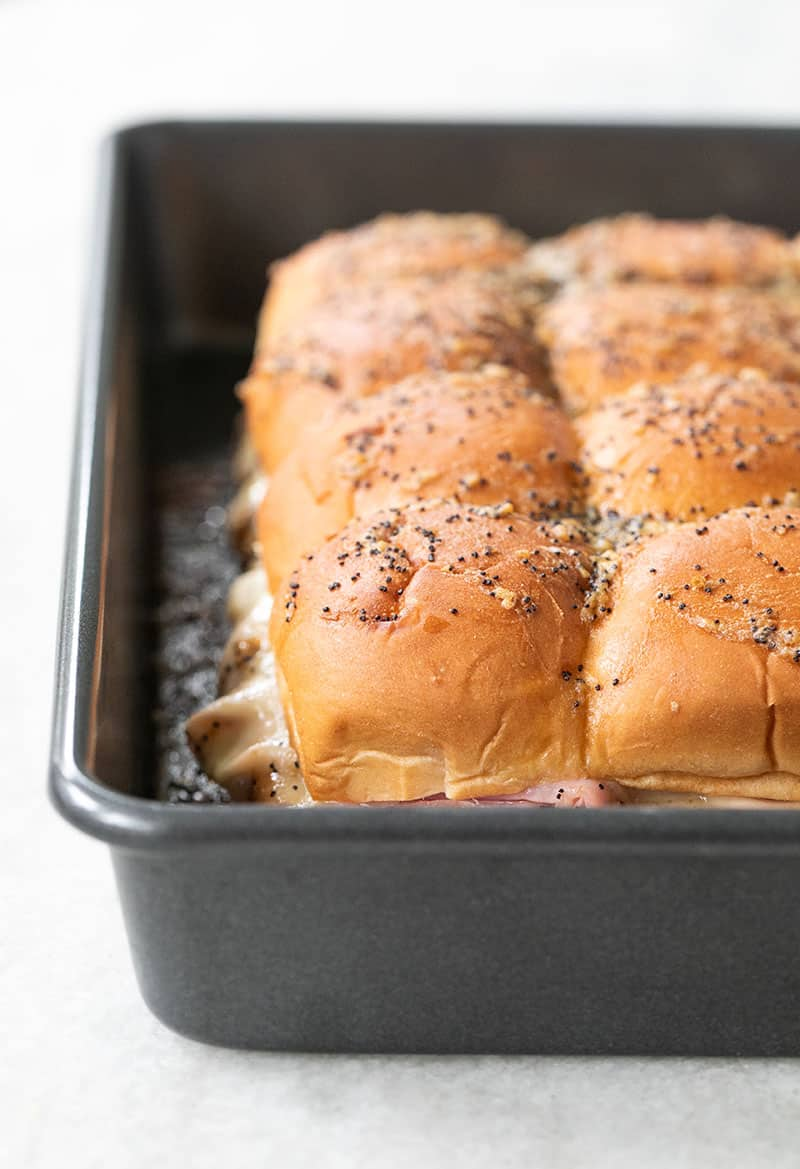 Ham and cheese sliders in a baking pan