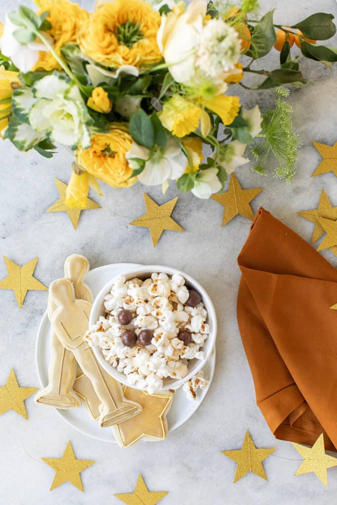 Popcorn with chocolate and Oscar cookies with gold stars.