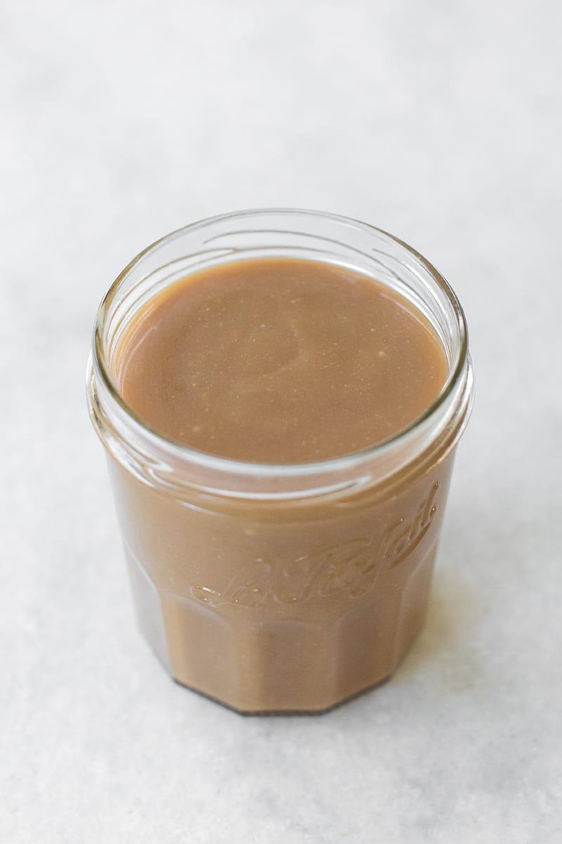 Caramel sauce in a glass jar.