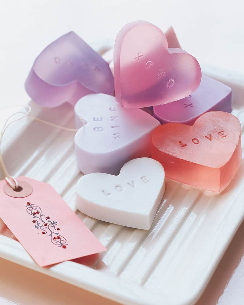 Homemade heart shaped soaps on a tray.