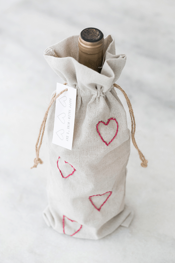 Valentine's Day wine bags with embroidery hearts.