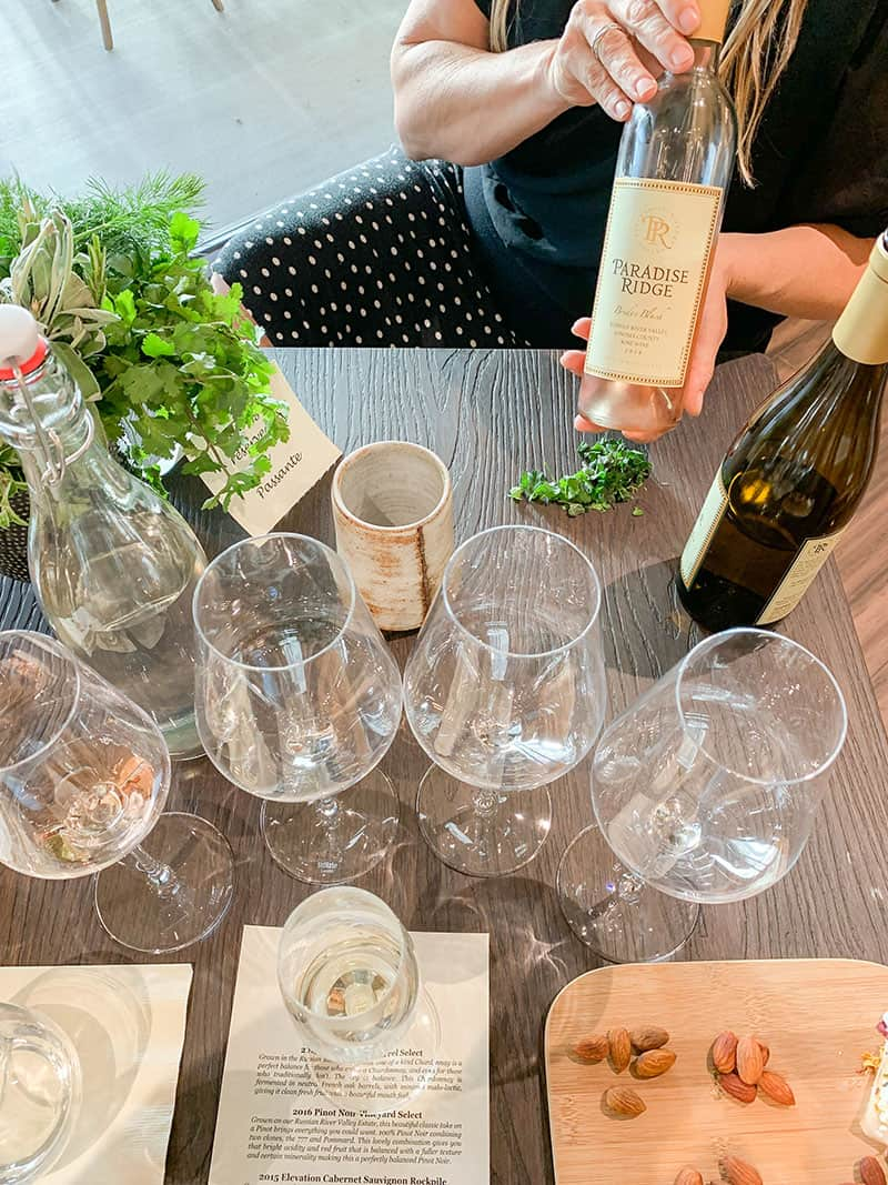 Herb and Wine tasting at Paradise Ridge Winery. Table full of glasses.