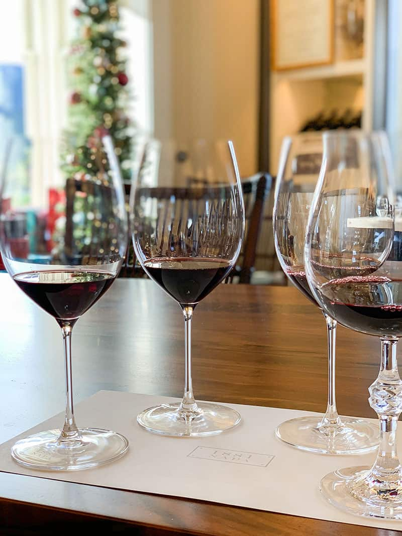 Four wine glasses filled with red wine at 1881 Napa