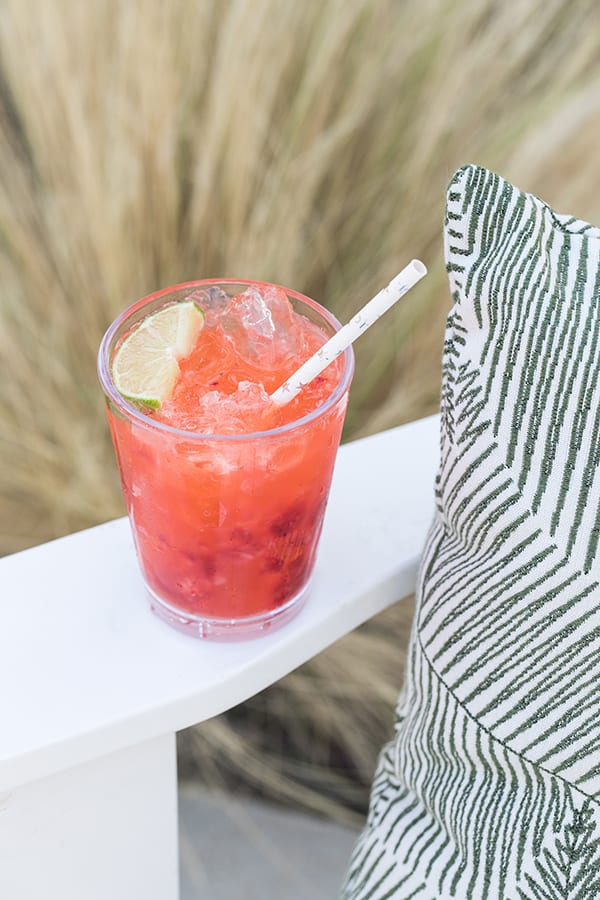Strawberry Tequila Sodas with lime and a pretty straw.