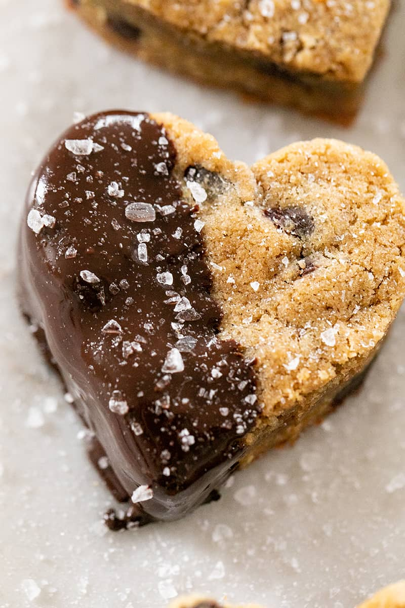 Heart shaped blondie dipped in chocolate with sea salt.
