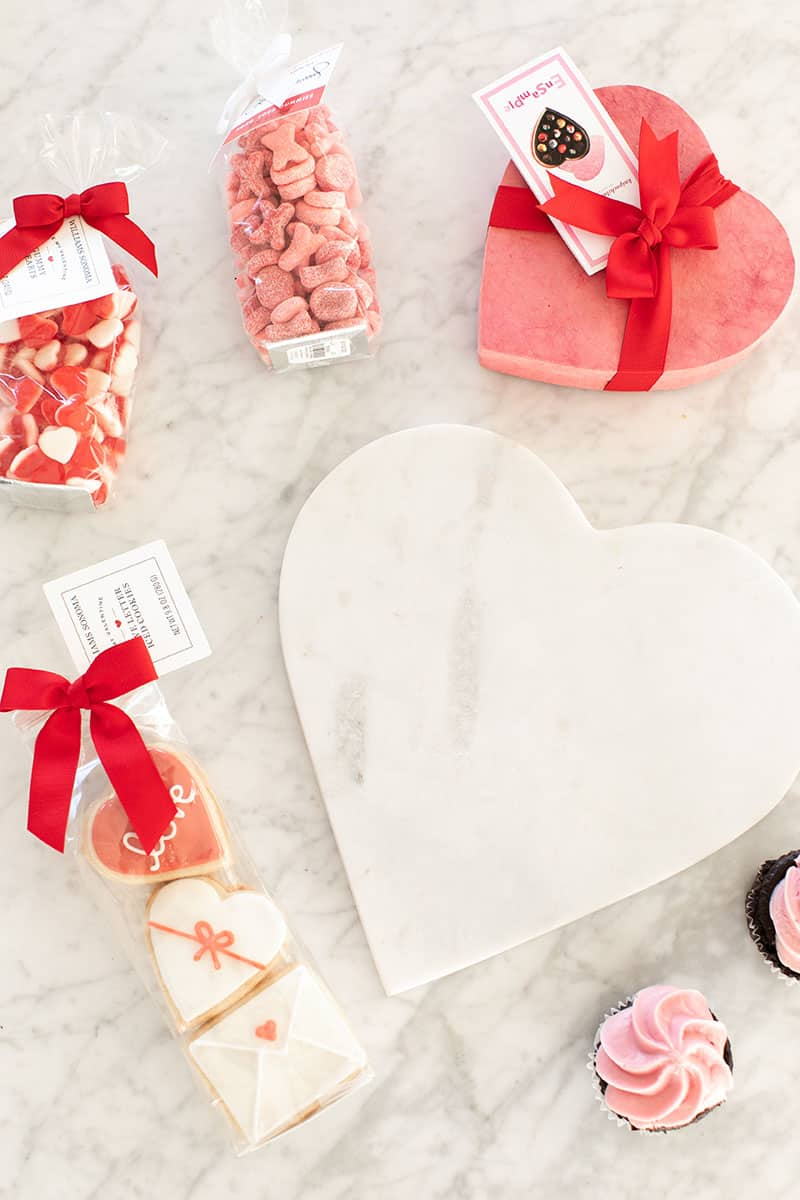 Marble heart shaped platter with cookies and cupcakes to make a dessert platter.