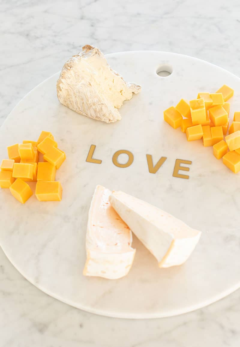 Cheese on a marble platter.
