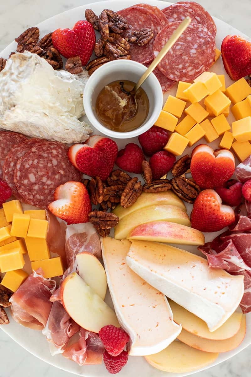 Meat and cheese on a marble platter.