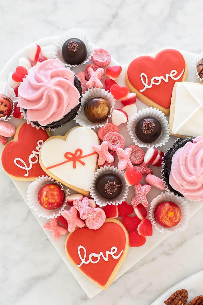 Valentine's Day Dessert Platter with cookies, gummies, cupcakes