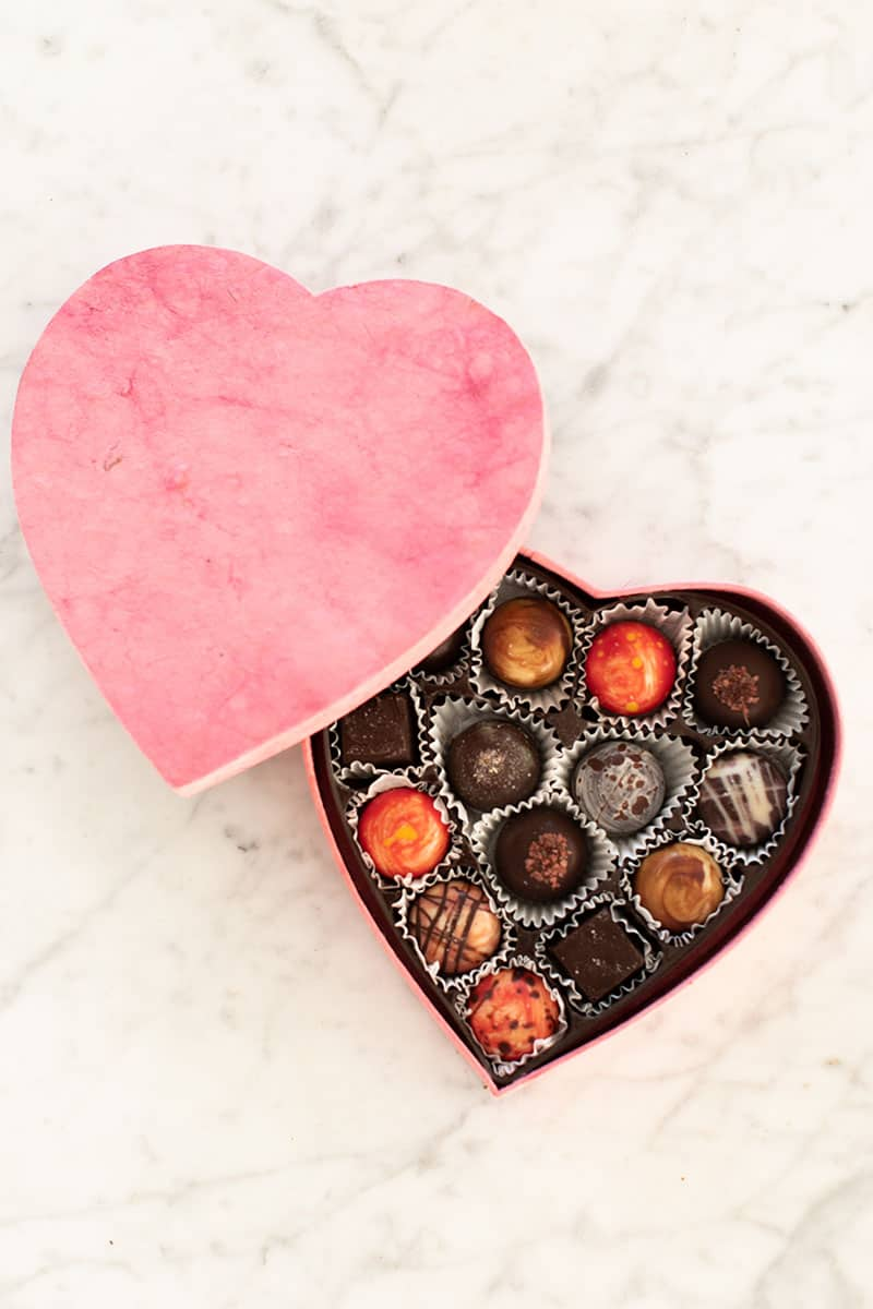 Chocolate truffles in a heart shaped pink box for dessert platter.
