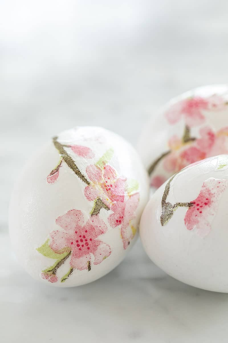Decoupage Easter eggs with cherry blossoms