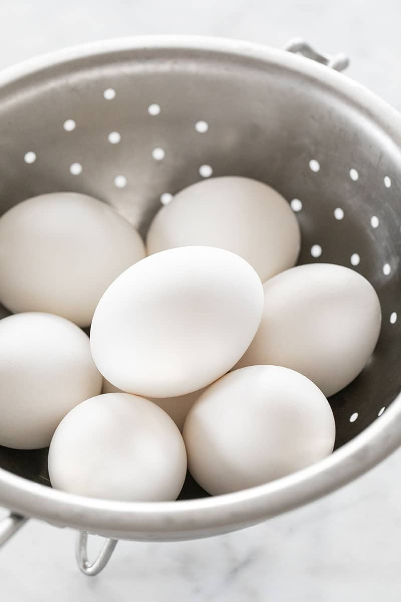 Hard boiled eggs in a strainer