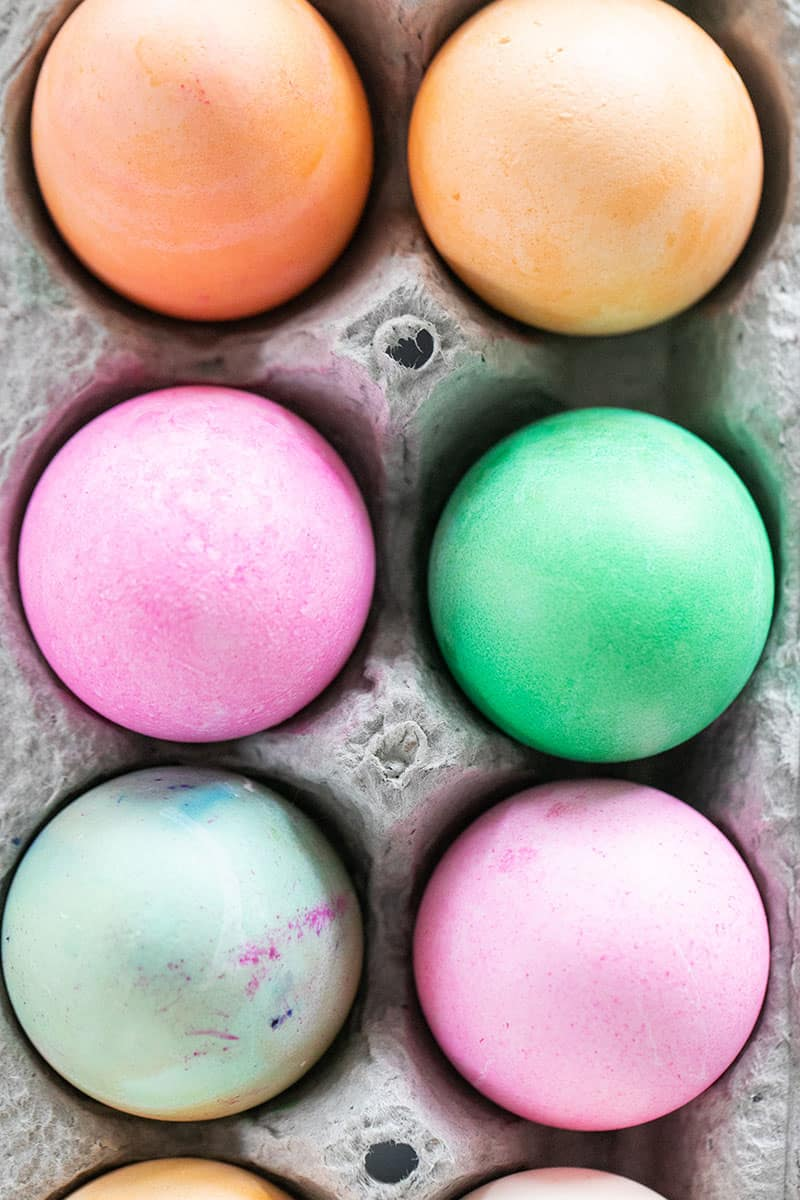 Colored Easter eggs in a carton.